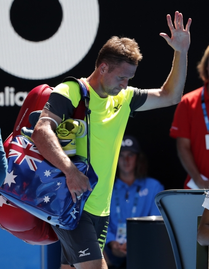 United States' Tennys Sandgren waves after losing to South Korea's Chung Hyeon in their quarterfinal at the Australian Open tennis championships in Melbourne, Australia, Wednesday, Jan. 24, 2018. (AP Photo/Vincent Thian)