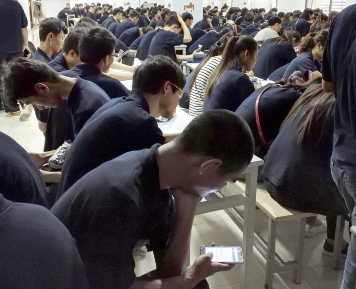 In this July 12, 2016, photo, workers receive job training at Apple supplier Jabil Inc.'s Green Point factory in Wuxi in eastern China's Jiangsu Province. Apple Inc. and Ivanka Trump's brand both rely on Chinese suppliers that have been criticized for workplace abuses. But they've taken contrasting approaches to dealing with supply chain problems. When Apple learned thousands of student workers at an iPhone supplier had been underpaid, it helped them get their money back. After three men investigating labor abuses at factories that made Ivanka Trump shoes were arrested last year, neither Ivanka Trump nor her brand spoke out. (AP Photo)