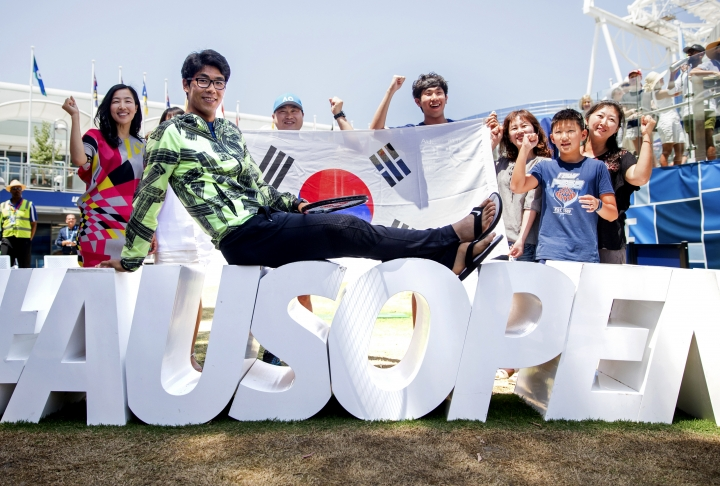South Korea's Hyeon Chung poses for a photo with supporters at the Australian Open tennis championships in Melbourne, Australia, Thursday, Jan. 25, 2018. Chung will play Switzerland's Roger Federer in a men's singles semifinal in Melbourne on Friday Jan. 26. (Fiona Hamilton/Tennis Australia via AP)