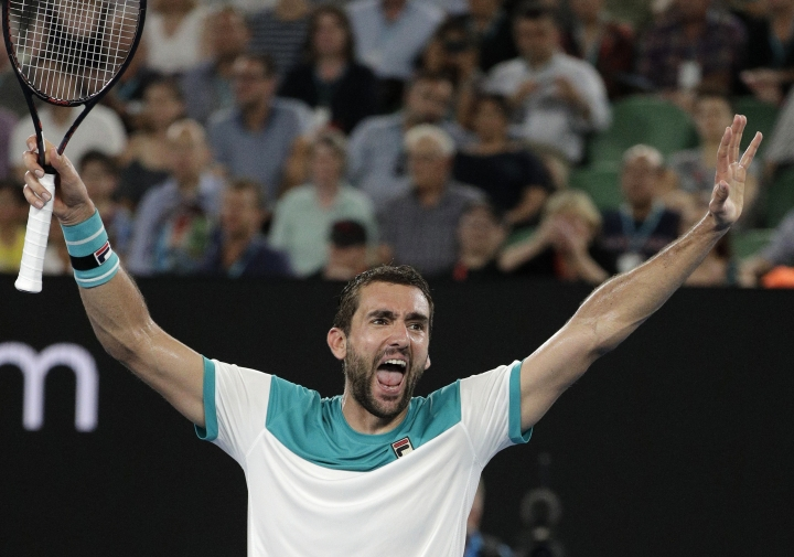 Croatia's Marin Cilic celebrates after defeating Britain's Kyle Edmund in their semifinal at the Australian Open tennis championships in Melbourne, Australia, Thursday, Jan. 25, 2018. (AP Photo/Dita Alangkara)