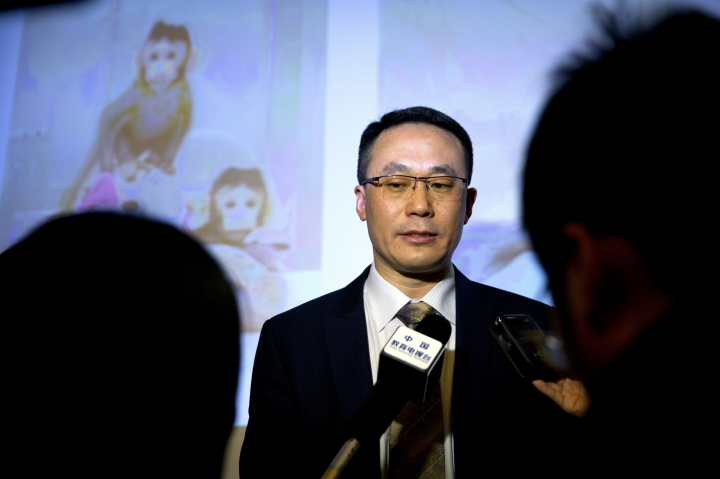 Sun Qiang, the director of the Nonhuman Primate Facility of the Institute of Neurosciences at the Chinese Academy of Sciences speaks to reporters after a press conference at the Chinese Academy of Sciences in Beijing, Wednesday, Jan. 24, 2018. For the first time, researchers have used the cloning method that produced Dolly the sheep to create two healthy monkeys, potentially bringing scientists closer to being able to do that with humans. (AP Photo/Mark Schiefelbein)