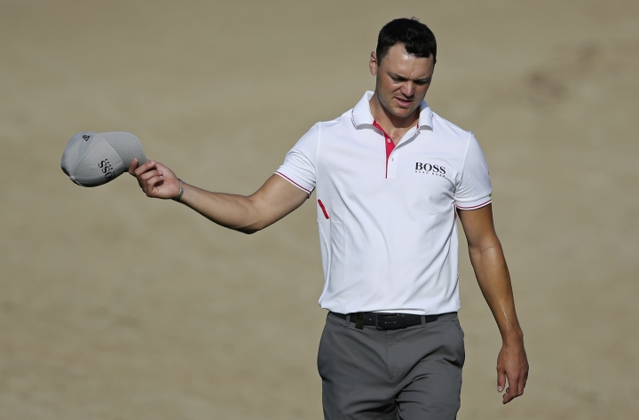 Germany's Martin Kaymer reacts on the 14th hole during the first round of the Dubai Desert Classic golf tournament in Dubai, United Arab Emirates, Thursday, Jan. 25, 2018. (AP Photo/Kamran Jebreili)
