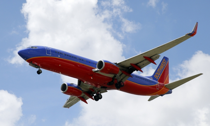 FILE - In this Aug. 26, 2016, file photo, a Southwest Airlines jet makes its approach to Dallas Love Field airport, in Dallas. Southwest Airlines Co. reports earnings, Thursday, Jan. 25, 2018. (AP Photo/Tony Gutierrez, File)