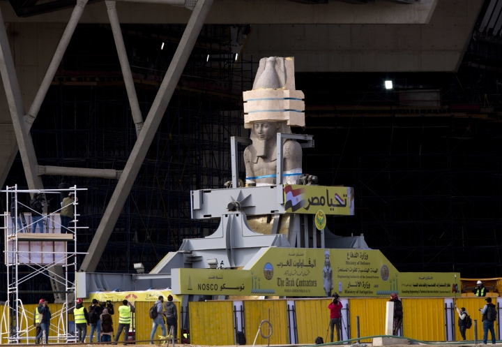 "A giant statue of pharaoh Ramses II arrives at the at the atrium of the Grand Egyptian Museum in Cairo, Egypt, Thursday, Jan. 25, 2018. The museum is scheduled to open later this year. Arabic reads, ""Long live Egypt."" (AP Photo/Amr Nabil)"