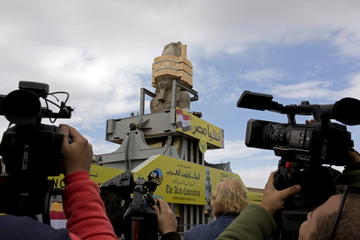 "Cameramen film a giant statue of the pharaoh Ramses II as it is relocated at the Grand Egyptian Museum, in Cairo, Egypt, Thursday, Jan. 25, 2018. The museum is scheduled to open later this year. Arabic reads, ""long live Egypt."" (AP Photo/Amr Nabil)"