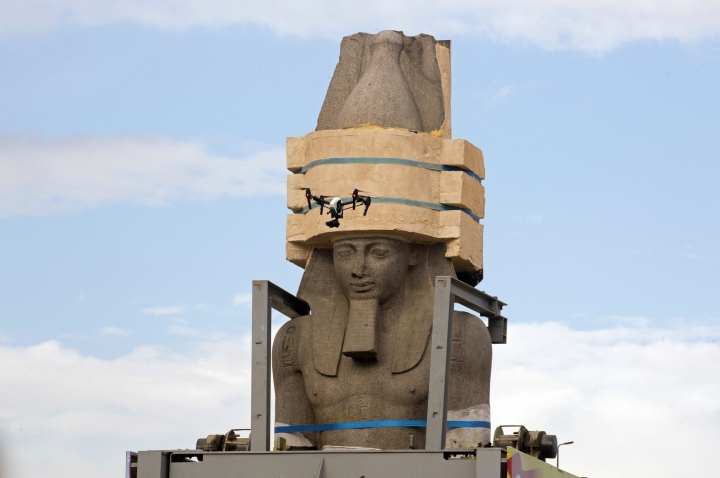 A drone films a giant statue of the pharaoh Ramses II as it is relocated at the Grand Egyptian Museum, in Cairo, Egypt, Thursday, Jan. 25, 2018. The museum is scheduled to open later this year. (AP Photo/Amr Nabil)