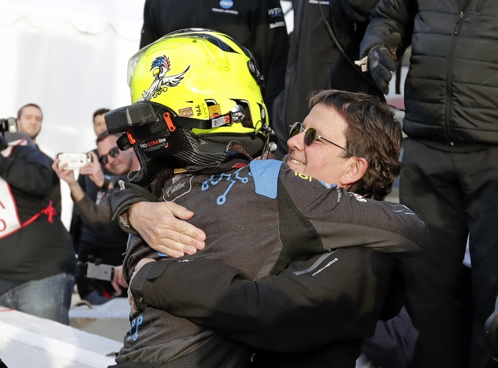 Renger Van Der Zande, left, of the Netherlands, gets hug from team owner Wayne Taylor after qualifying for the pole position in the IMSA 24-hour auto race at Daytona International Speedway, Thursday, Jan. 25, 2018, in Daytona Beach, Fla. (AP Photo/John Raoux)