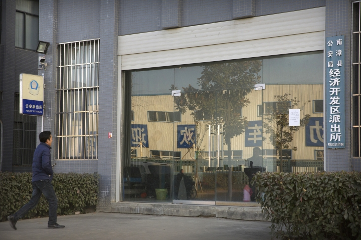 In this Dec. 18, 2017, photo, Chinese labor activist Hua Haifeng walks toward the front door of a local police station as he prepares to do a weekly check-in with officials on the outskirts of Xiangyang in central China's Hubei Province. Apple Inc. and Ivanka Trump's brand both rely on Chinese suppliers that have been criticized for workplace abuses. But they've taken contrasting approaches to dealing with supply chain problems. When Apple learned thousands of student workers at an iPhone supplier had been underpaid, it helped them get their money back. After three men investigating labor abuses at factories that made Ivanka Trump shoes were arrested last year, neither Ivanka Trump nor her brand spoke out. (AP Photo/Mark Schiefelbein)