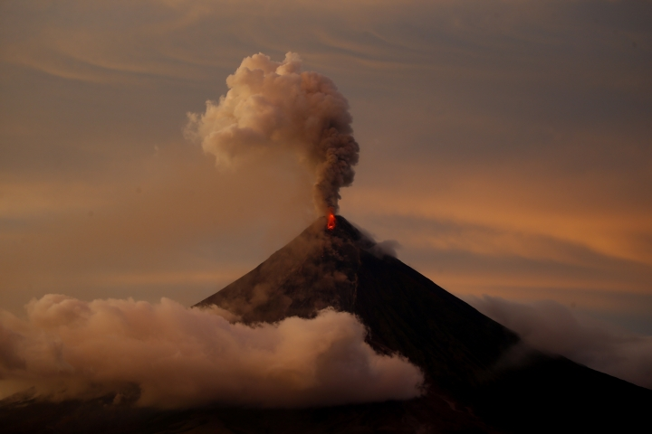 In this Thursday, Jan. 26, 2018, file photo, the Mayon volcano erupts anew at sunset in Albay province around 200 miles (340 kilometers) southeast of Manila, Philippines. (AP Photo/Bullit Marquez, File)