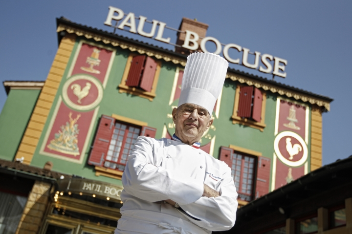 FILE - In this March 24, 2011 file French Chef Paul Bocuse poses outside his famed Michelin three-star restaurant L'Auberge du Pont de Collonges in Collonges-au-Mont-d'or, central France. Hundreds of chefs and French dignitaries are gathering in the culinary mecca of Lyon for the funeral of Paul Bocuse, a master chef who defined French cuisine for more than a half-century and put it on tables around the world. (AP Photo/Laurent Cipriani, File)