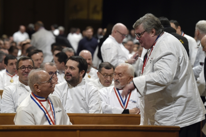 French chefs Joel Robuchon, left first row, and Jean-François Piege, center left, attend the funeral ceremony for French Paul Bocuse at the Saint-Jean cathedral, in Lyon, central France, Friday, Jan. 26, 2018. Hundreds of chefs and French dignitaries are gathering in the culinary mecca of Lyon for the funeral of Paul Bocuse, a master chef who defined French cuisine for more than a half-century and put it on tables around the world. (Philippe Desmazes/Pool Photo via AP)