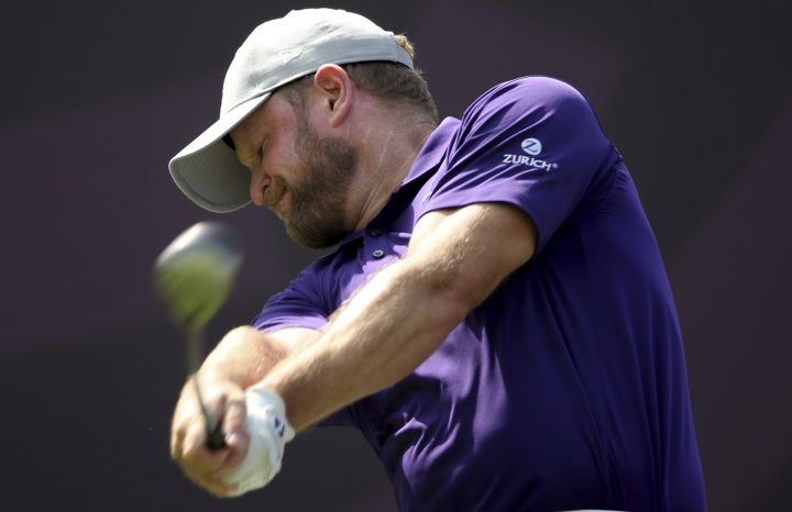 Jamie Donaldson of Wales tees off on the 2nd hole during the second round of the Dubai Desert Classic golf tournament in Dubai, United Arab Emirates, Friday, Jan. 26, 2018. (AP Photo/Kamran Jebreili)