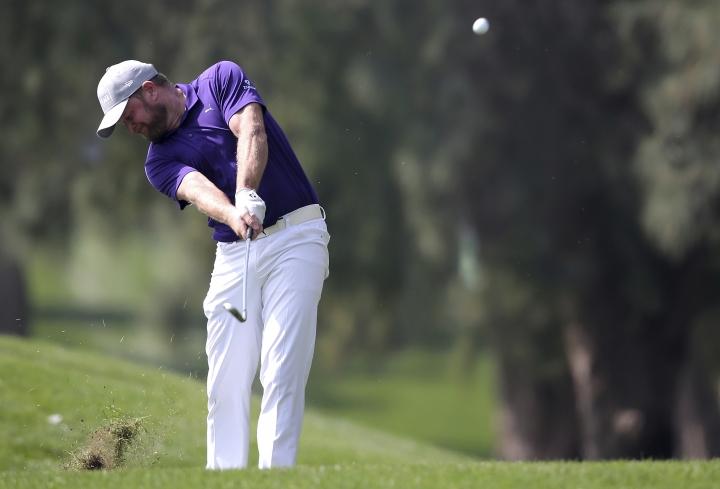 Jamie Donaldson of Wales plays a shot on the 1st hole during the second round of the Dubai Desert Classic golf tournament in Dubai, United Arab Emirates, Friday, Jan. 26, 2018. (AP Photo/Kamran Jebreili)