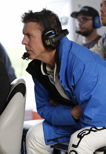 Scott Pruett watches a monitor of cars on the track from his pit stall during a practice session for the IMSA 24-hour auto race at Daytona International Speedway, Friday, Jan. 26, 2018, in Daytona Beach, Fla. Pruett will call it a career after this weekend's race At Daytona. (AP Photo/John Raoux)