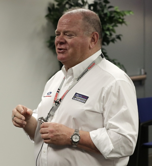 Team owner Chip Ganassi, center, answers questions during a news conference for the IMSA 24-hour auto race at Daytona International Speedway, Friday, Jan. 26, 2018, in Daytona Beach, Fla. (AP Photo/John Raoux)