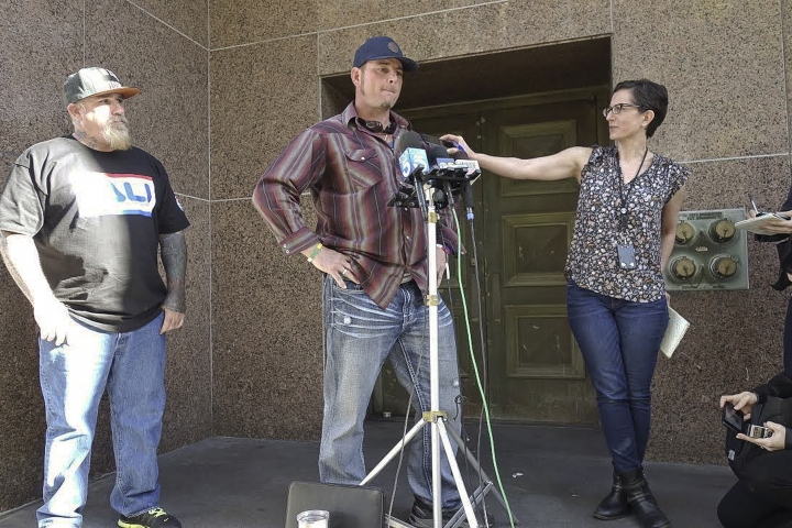 Jason Freeman, center,Charles Manson's purported grandson, speaks to reporters outside court in Los Angeles, Friday, Jan. 26, 2018. The fight for the corpse of Manson was thrown out of a Los Angeles court Friday as another potential heir stepped into the case. In a hearing to determine the venue for legal battles over Manson's estate and the disposition of his remains, Freeman, whose father was born by Manson's first wife, echoed the frustration of several parties who have been trying to get control of the notorious criminal's body since he died in November. (AP Photo/Brian Melley)