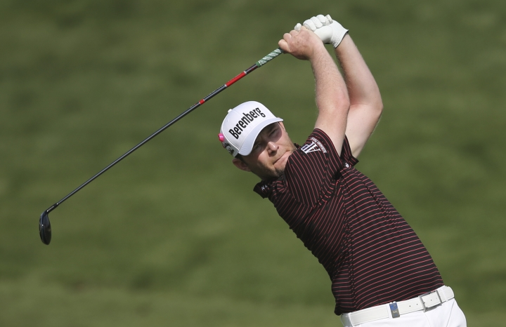 South Africa's Branden Grace plays a shot on the 10th hole during the second round of the Dubai Desert Classic golf tournament in Dubai, United Arab Emirates, Friday, Jan. 26, 2018. (AP Photo/Kamran Jebreili)