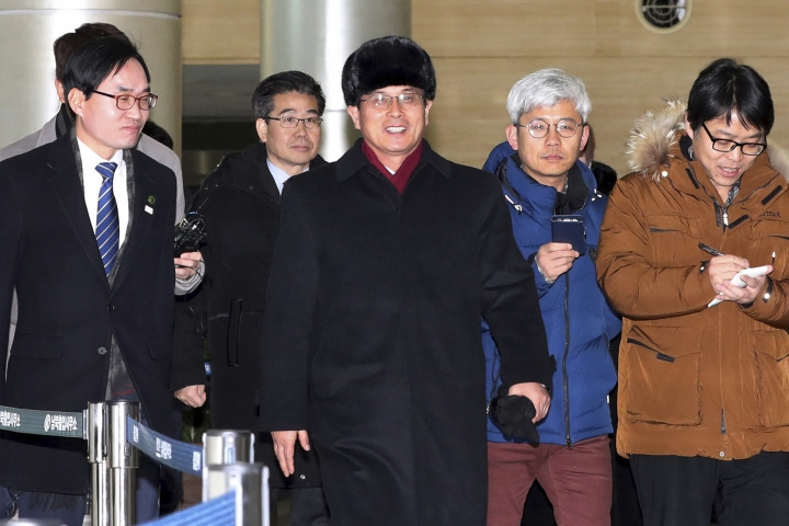 Yun Yong Bok, center, deputy director of the North Korean Ministry of Physical Culture and Sports, arrives at the Customs Immigration and Quarantine office in Paju, South Korea, to return home Saturday, Jan. 27, 2018. North Korean officials on Saturday wrapped up a three-day visit to South Korea where they examined Olympic stadiums, hotels and concert halls that will potentially be used by North Korean athletes and other delegates headed to next month's Pyeongchang Winter Games. (Korea Pool/Yonhap via AP)