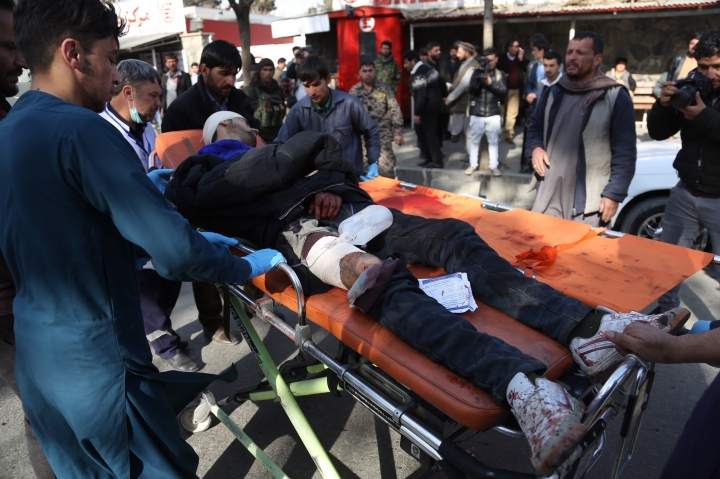 An injured man arrives outside a hospital following a suicide attack in Kabul, Afghanistan, Saturday Jan. 27, 2018. The Public Health Ministry says over a dozen were killed, and over 100 wounded in a suicide car bombing in downtown Kabul. (AP Photo/ Rahmat Gul)