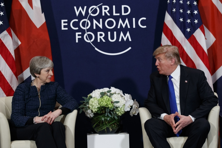 FILE - A Thursday, Jan. 25, 2018 file photo of US President Donald Trump meeting with British Prime Minister Theresa May at the World Economic Forum in Davos, Switzerland. President Donald Trump has wished Prince Harry and fiancee Meghan Markle well and says he is not aware of having received an invitation to their royal wedding in May. (AP Photo/Evan Vucci, File)