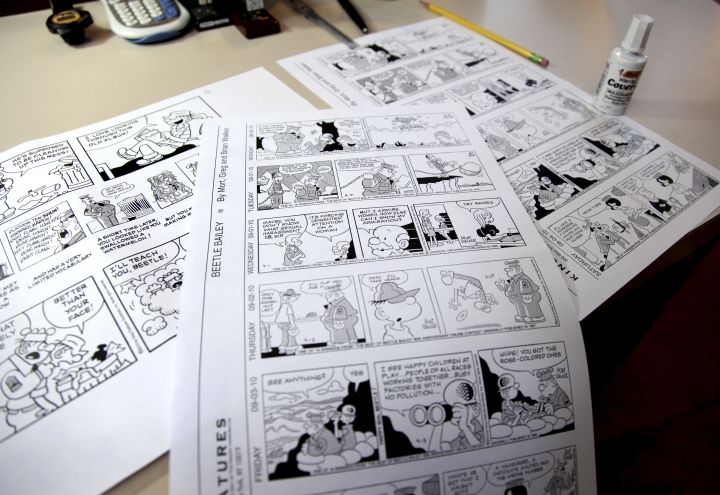 FILE - In this Aug. 16, 2010 file photo, Beetle Bailey comic strips that will be published in the coming weeks rest on a desk in the studio of creator Mort Walker in Stamford, Conn. On Saturday, Jan. 27, 2018, a family member said the comic strip artist has died. He was 94. (AP Photo/Craig Ruttle)