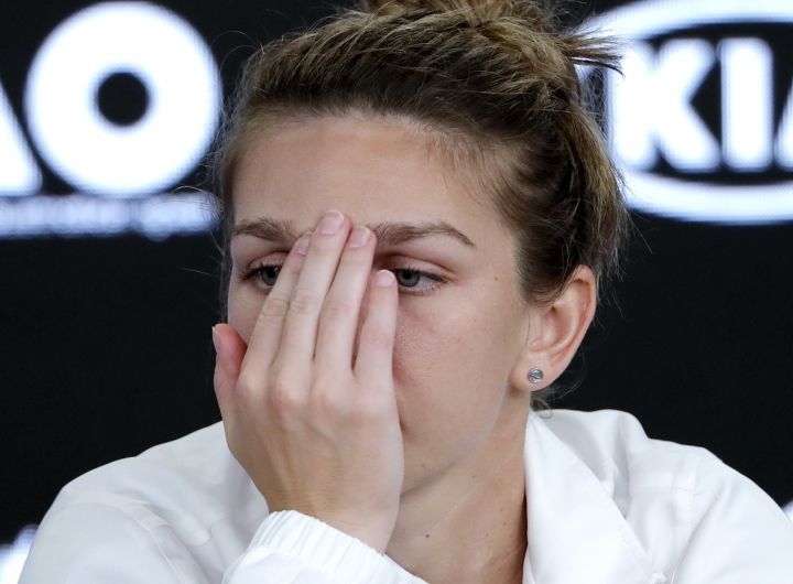 Romania's Simona Halep answers questions at press conference following her loss to Denmark's Caroline Wozniacki in the women's singles final at the Australian Open tennis championships in Melbourne, Australia, Saturday, Jan. 27, 2018. (AP Photo/Vincent Thian)