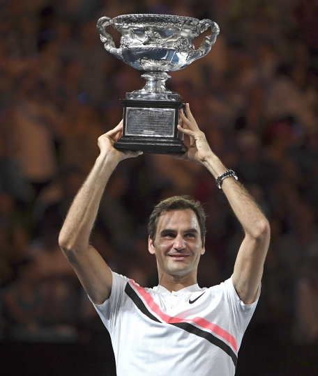Switzerland's Roger Federer holds his trophy aloft after defeating Croatia's Marin Cilic during the men's singles final at the Australian Open tennis championships in Melbourne, Australia, Sunday, Jan. 28, 2018. (AP Photo/Andy Brownbill)