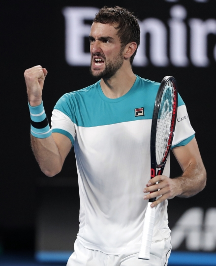 Croatia's Marin Cilic reacts after winning a point against Switzerland's Roger Federer during the men's singles final at the Australian Open tennis championships in Melbourne, Australia, Sunday, Jan. 28, 2018. (AP Photo/Vincent Thian)