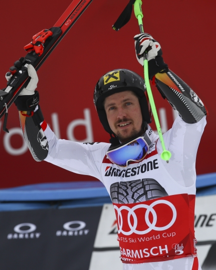Austria's Marcel Hirscher celebrates after winning an alpine ski, men's World Cup giant slalom, in Garmisch Partenkirchen, Germany, Sunday, Jan. 28, 2018. (AP Photo/Marco Trovati)