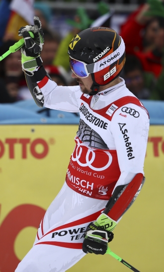 Austria's Marcel Hirscher gets to the finish line after the second run of an alpine ski, men's World Cup giant slalom, in Garmisch Partenkirchen, Germany, Sunday, Jan. 28, 2018. (AP Photo/Marco Trovati)