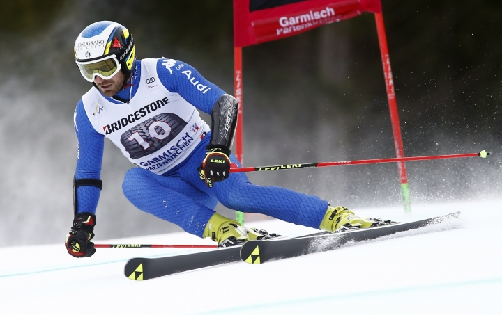 Italy's Manfred Moelgg speeds down the slope during the first run of an alpine ski, men's World Cup giant slalom, in Garmisch Partenkirchen, Germany, Sunday, Jan. 28, 2018. (AP Photo/Giovanni Auletta)