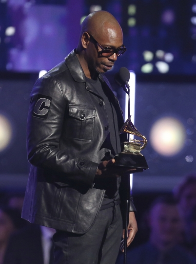"""Dave Chappelle accepts the award for best comedy album for """"The Age of Spin"""" and """"Deep In The Heart Of Texas"""" at the 60th annual Grammy Awards at Madison Square Garden on Sunday, Jan. 28, 2018, in New York. (Photo by Matt Sayles/Invision/AP)"""