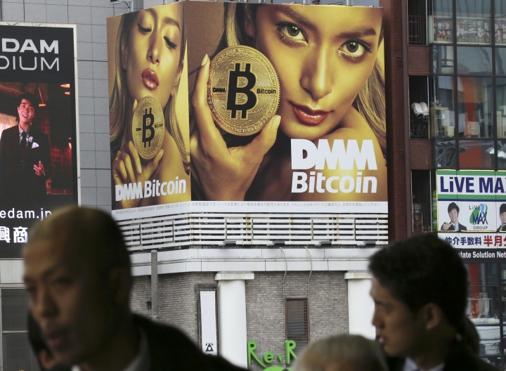 A huge advertisement of Bitcon is displayed near a train station in Tokyo Monday, Jan. 29, 2018. Blockchain is a decentralized technology that can make transactions safe and secure, but crypto-currency exchanges that trade bitcoins and other virtual currencies that are based on this technology have been hacked because they are not working on secure networks. (AP Photo/Koji Sasahara)