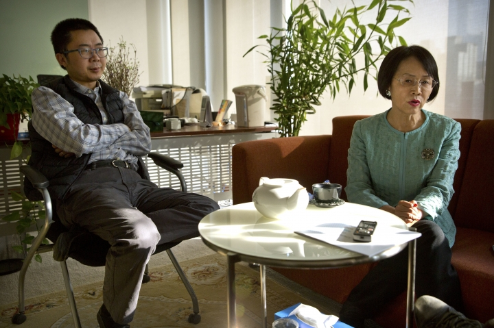 """In this Jan. 18, 2018 photo, Hu Shuli, right, publisher at Caixin Media, speaks as editor-in-chief Wang Shuo, left, listens during an interview at the Caixin offices in Beijing. In a rare interview with the Associated Press, Hu spoke bullishly about transitioning into a publisher role at Caixin, the newsmagazine she co-founded in 2009, and the prospect of doing more to help Chinese women gain their rights as the """"Me Too"""" movement goes global. (AP Photo/Mark Schiefelbein)"""
