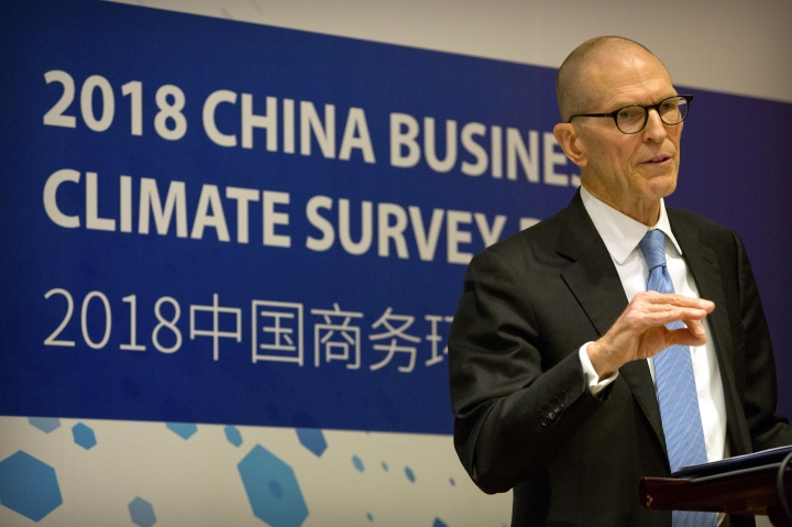 "William Zarit, the chairman of the American Chamber of Commerce in China, speaks at a press conference to unveil the group's 2018 China Business Climate Survey Report in Beijing, Tuesday, Jan. 30, 2018. The head of an American business group says Chinese officials have warned ""there will be retaliation"" if President Donald Trump launches trade remedies in disputes over technology, steel and other issues. (AP Photo/Mark Schiefelbein)"