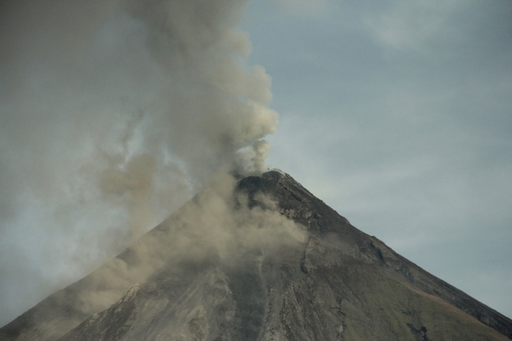 Molten lava flows down the slopes of Mayon volcano during its mild eruption as seen from Legazpi city, Albay province, southeast of Manila, Philippines Tuesday, Jan. 30, 2018. Mayon's lava fountaining has flowed up to 3 kilometers (1.86 miles) from the crater in a dazzling but increasingly dangerous eruption. (AP Photo/Bogie Calupitan)