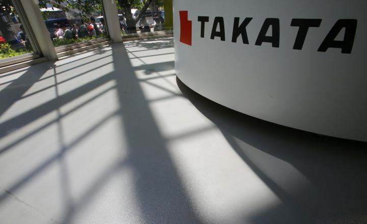 In this May 4, 2016, photo, shadows are cast near a Takata Corp.'s reception desk at the automaker's showroom in Tokyo. Another person has died in Malaysia after a faulty Takata airbag inflator exploded when the Honda it was installed in crashed, raising the known death toll linked to the defect in the Southeast Asian country to six. The driver was killed when the 2004 Honda City car crashed on New Year's Day in central Selangor state, Honda Malaysia said Tuesday, Jan. 30, 2018 in a statement. (AP Photo/Shizuo Kambayashi)