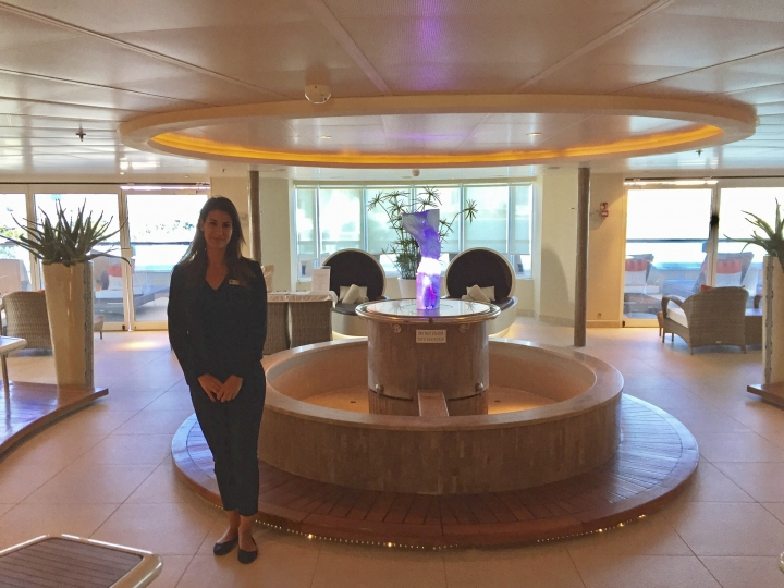 This Jan. 4, 2018 photo shows Eva Santiago, a crew member on Seabourn Sojourn, on a tour of the ship in the port of Miami. The Sojourn carries up to 450 guests, with 360 crew members. While massive cruise ships carrying thousands of people have gotten a lot of publicity in recent years, there's also been a boom in popularity for smaller ships like this one with more intimate spaces and customized service. (AP Photo/Beth J. Harpaz)