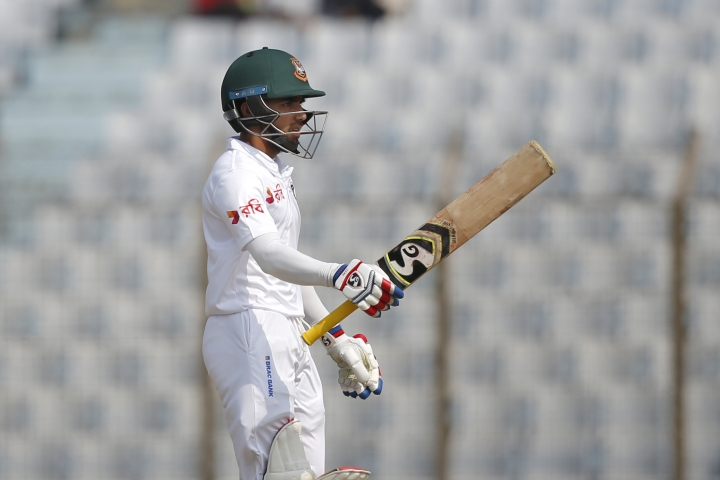Bangladesh's Mominul Haque acknowledges the crowed after scoring fifty runs during the first day of their first test cricket match against Sri Lanka in Chittagong, Bangladesh, Wednesday, Jan. 31, 2018. (AP Photo/A.M. Ahad)