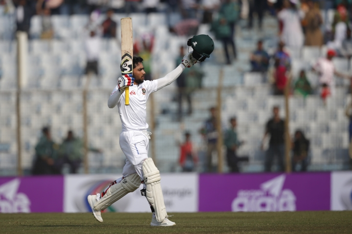 Bangladesh's Mominul Haque acknowledges the crowed after scoring hundred runs during the first day of their first test cricket match against Sri Lanka in Chittagong, Bangladesh, Wednesday, Jan. 31, 2018. (AP Photo/A.M. Ahad)