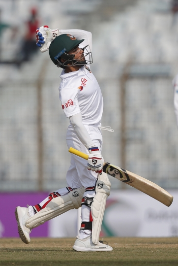 Bangladesh's Mominul Haque celebrates after scoring hundred runs during the first day of their first test cricket match against Sri Lanka in Chittagong, Bangladesh, Wednesday, Jan. 31, 2018. (AP Photo/A.M. Ahad)