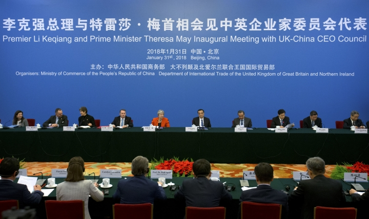 British Prime Minister Theresa May, center left, and Chinese Premier Li Keqiang, center right, listen to a speaker during the inaugural meeting of the UK-China CEO Council at the Great Hall of the People in Beijing, Wednesday, Jan. 31, 2018. (AP Photo/Mark Schiefelbein, Pool)