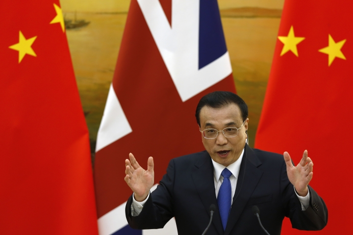 Chinese Premier Li Keqiang gestures as he speaks during a joint press conference with British Prime Minister Theresa May at the Great Hall of the People in Beijing, Wednesday, Jan. 31, 2018. (AP Photo/Andy Wong, Pool)