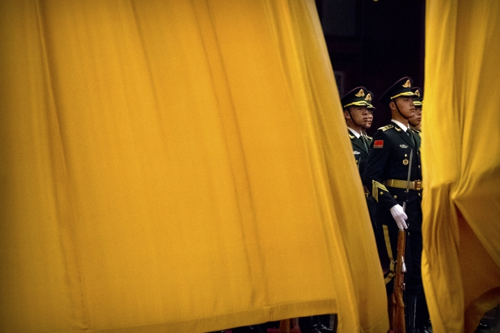 Members of the Chinese honor guard march in formation past a curtain before a welcome ceremony for British Prime Minister Theresa May at the Great Hall of the People in Beijing, Wednesday, Jan. 31, 2018. (AP Photo/Mark Schiefelbein)