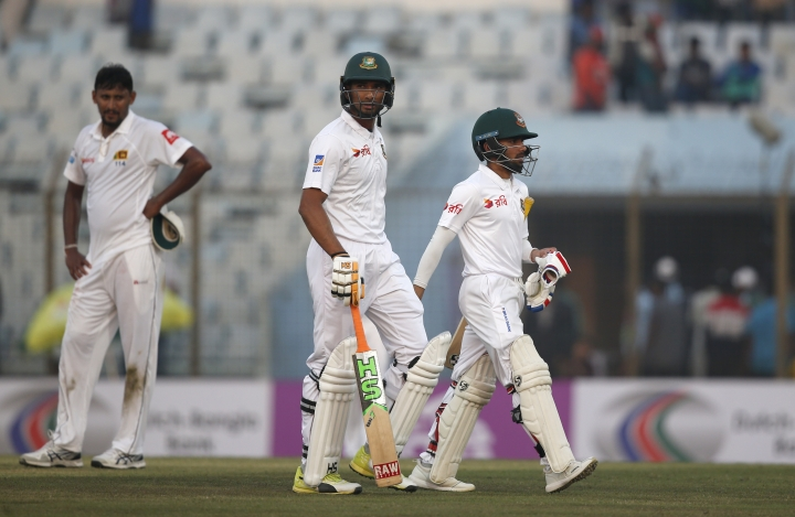 Bangladesh's captain Mahmudullah, center, and teammate Mominul Haque, right, walk leave the ground after end of the first day of their first test cricket match against Sri Lanka in Chittagong, Bangladesh, Wednesday, Jan. 31, 2018. (AP Photo/A.M. Ahad)