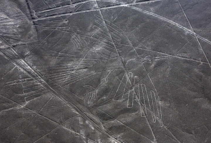 FILE - This Dec. 8, 2014 file photo shows an aerial view of the condor geoglyph in the Nazca desert, in southern Peru. Authorities in Peru detained a truck driver accused of damaging part of the world-renowned Nazca lines. The nation's Ministry of Culture says Jainer Flores drove into an unauthorized section of the U.N. World Heritage site on Saturday, Jan. 27, 2018, leaving tracks and damaging part of three lines. (AP Photo/Rodrigo Abd, File)