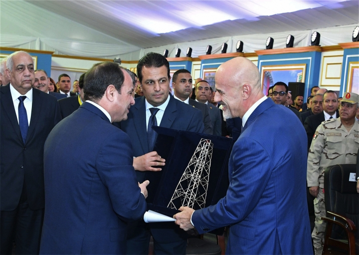 CEO Claudio Descalzi of the Italian energy firm Eni, center right, presents Egyptian President Abdel-Fattah el-Sissi with a gift during a ceremony marking the start of a massive gas project, Wednesday Jan. 31, 2018, in Port Said, Egypt. During the ceremony el-Sissi again accused unknown parties of being behind the 2016 murder in Egypt of Italian researcher Giulio Regeni, alleging a plot to sabotage bilateral relations. He pledged Egypt would help bring the killers of the 28-year-old researcher to justice. (MENA via AP)