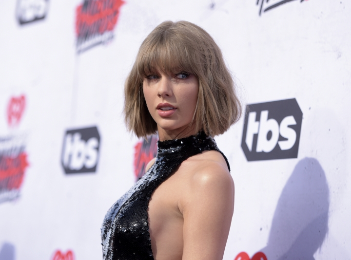 "FILE - In this April 3, 2016 file photo, Taylor Swift arrives at the iHeartRadio Music Awards at The Forum in Inglewood, Calif. The man fired from his radio DJ job for groping Swift has been hired by a Mississippi radio station.Delta Radio CEO David Fuss tells news outlets he believes David Mueller's side of the story and hired him because he sounds good on air. Swift sued Mueller for a dollar last year, saying he grabbing her bare backside while posing for photo. Mueller, who uses the last name ""Jackson"" on air, denies the allegation and started co-hosting a show on Monday, Jan. 29, 2018, called ""Jackson and Jonbob.""(Photo by Richard Shotwell/Invision/AP, File)"