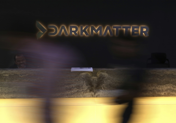 In this Tuesday, Jan. 30, 2018 photo, taken with a long exposure, employees walk into offices of the cybersecurity firm DarkMatter, in Abu Dhabi, United Arab Emirates. DarkMatter, a growing cybersecurity company that's recruited Western intelligence analysts, is slowly stepping out of the shadows amid activist concerns about its power. CEO Faisal al-Bannai says DarkMatter takes part in no hacking but acknowledges the firm's close business ties to the Emirati government, as well as hiring former CIA and National Security Agency analysts. (AP Photo/Jon Gambrell)