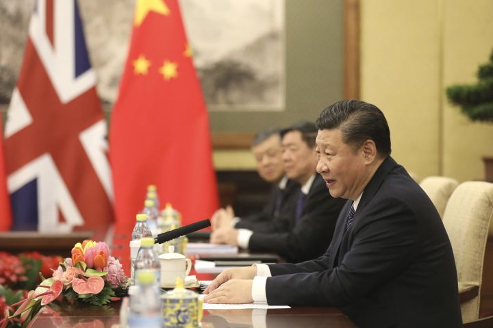 Chinese President Xi Jinping speaks to British Prime Minister Theresa May (not pictured) during a meeting at the Diaoyutai State Guesthouse in Beijing, Thursday, Feb. 1, 2018. (Wu Hong/Pool Photo via AP)
